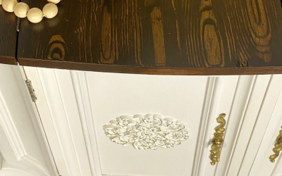 Painted white cabinet with a faux wood grain top